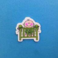Украшение из дерева малыш в кроватке зелёной